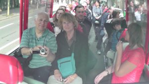 Charles Oropallo and Susan Oropallo on a tour bus on route to the Eiffel Tower on July 12, 2014. Photo through rear view mirror by Charles Oropallo.